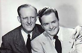 Portrait of bandleader Kay Kyser with vocalist Michael Douglas