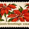 "22-cent USA stamp with poinsettias, reads ""Season's Greetings"""