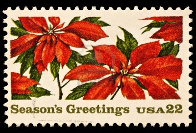"""22-cent USA stamp with poinsettias, reads """"Season's Greetings"""""""