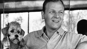 Photograph of Les Baxter with a dog at his side.