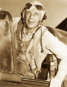 photograph of actor Wayne Morris, in flight suit, in an airplane cockpit