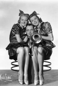 Tommy Dorsey and his trombone, and 2 un-named actresses, date unknown