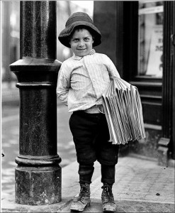 Old-fashioned newsboy on a streetcorner